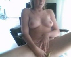 Sexy blonde cam girl playing with her toy